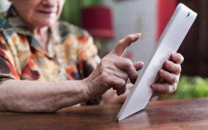Older person holding tablet