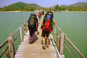 Backpackers on a wharf