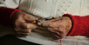 elderly woman hands knitting