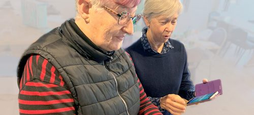 two women holding mobile phones, tech-savvy seniors