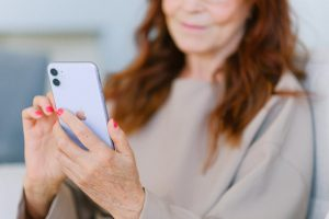 lady holding mobile phone